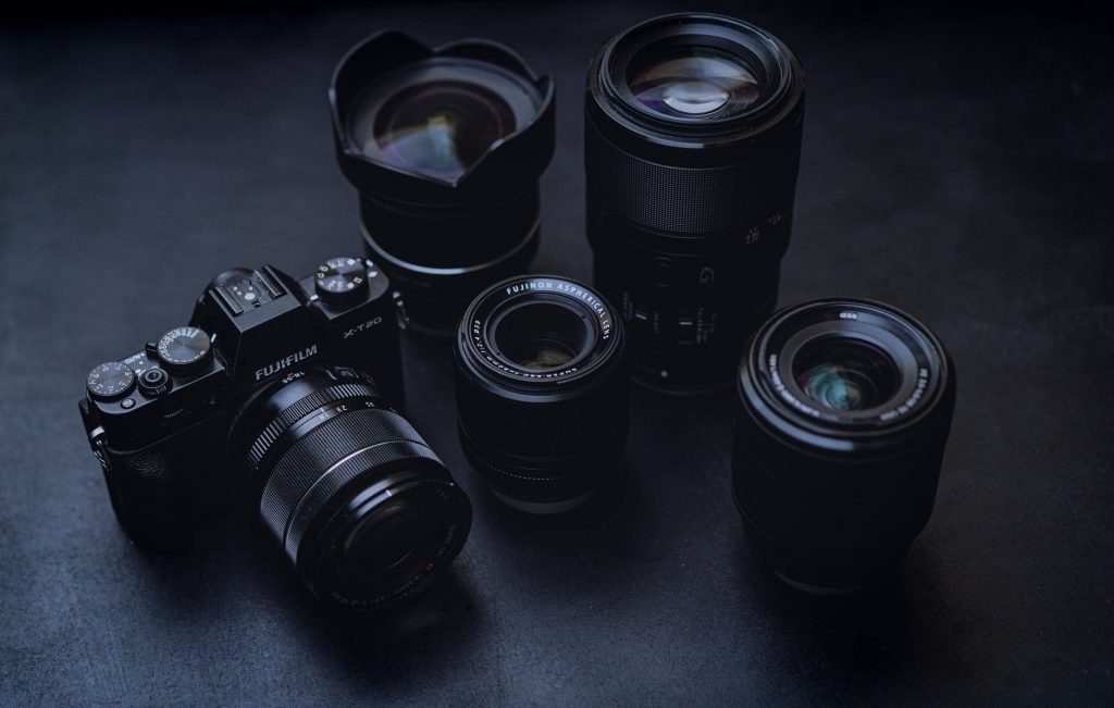 digital camera with different lenses on table